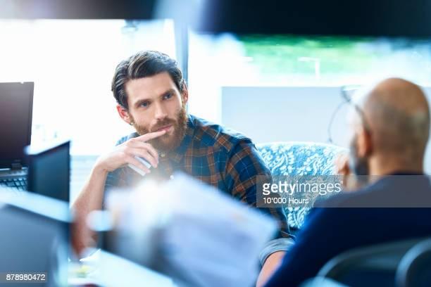 Men working in modern office