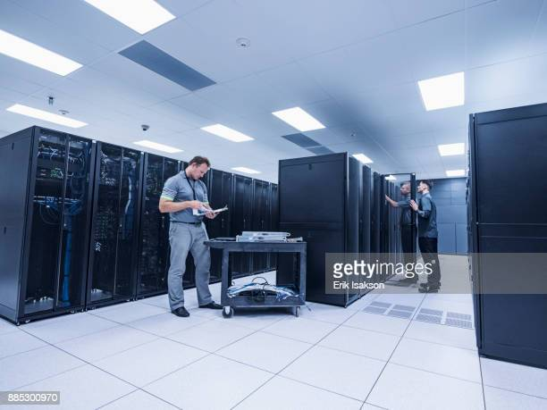 men working in server room - server room stock pictures, royalty-free photos & images