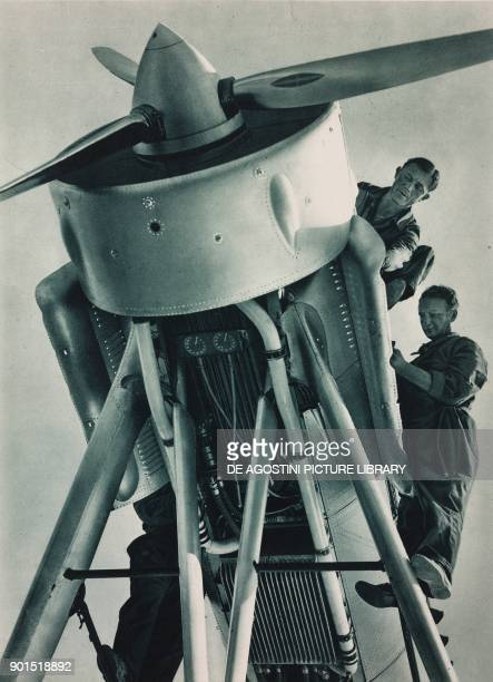 Men working on one of the aircraft used for the second Byrd expedition to the South Pole photo from L'illustrazione Italiana year LXI n 33 August 19...