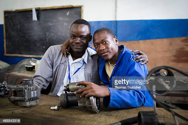 Men working on replacement parts in an auto repair shop on September 29 2015 in Beira Mozambique