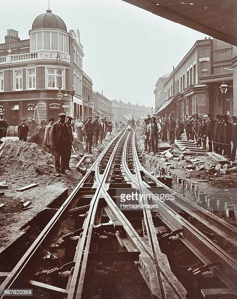 Men working on tramline electricification Wandsworth London 1906 Men at work on interlacing the track near Wandsworth Town Station by the junction...