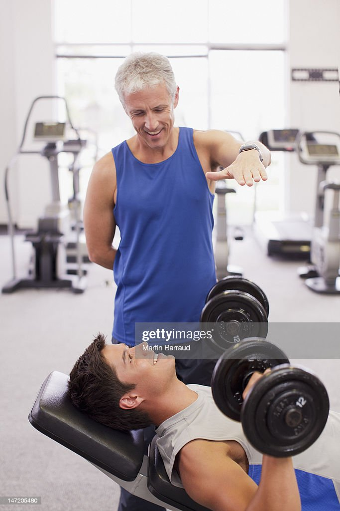 Men working out in gymnasium : Stock Photo