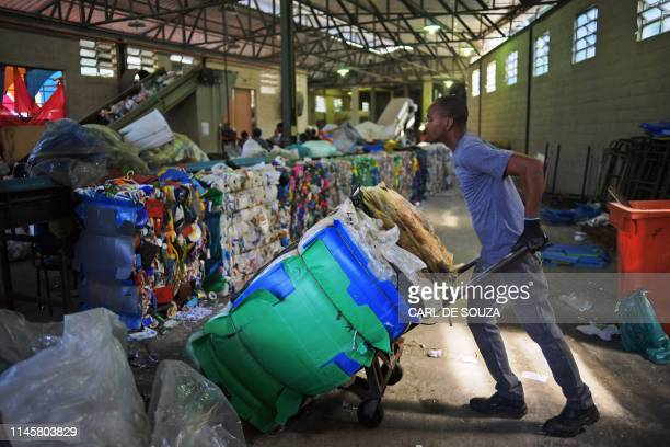 A men works in the recycling of plastic bags at CoopFuturo a sorting collective which receives rubbish from the local government collection service...