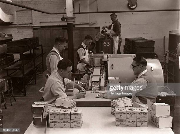 Men wrapping Rowntree's Fruit Gums and packing into boxes Rowntree factory York Yorkshire 1955