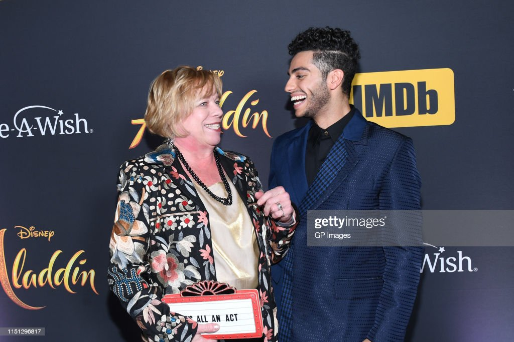 Mena Massoud and a guest attend the 'Aladdin' Canadian