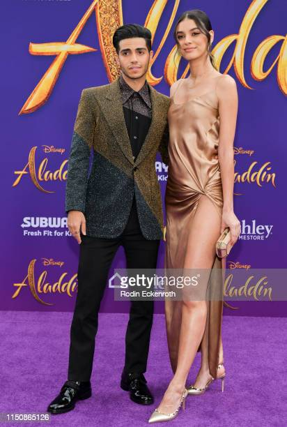"""Mena Massoud and Laysla De Oliveira attend the premiere of Disney's """"Aladdin"""" on May 21, 2019 in Los Angeles, California."""