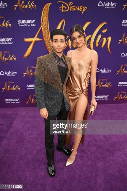 Mena Massoud and Laysla de Oliveira attend the World Premiere of Disney's Aladdin at the El Capitan Theater in Hollywood CA on May 21 in the...