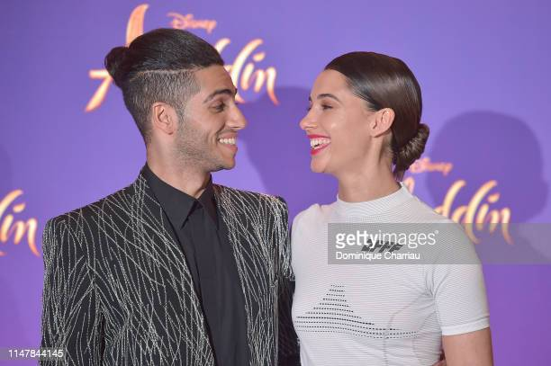 "Mena Massoud and Naomi Scott attend the ""Aladdin"" Paris Gala Screening at Cinema Le Grand Rex on May 08 2019 in Paris France"