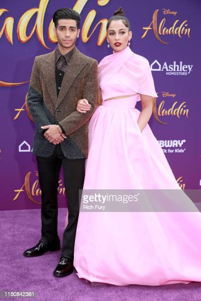 """Mena Massoud and Naomi Scott attend the premiere of Disney's """"Aladdin"""" on May 21, 2019 in Los Angeles, California."""