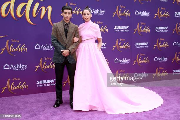 Mena Massoud and Naomi Scott attend the premiere of Disney's Aladdin on May 21 2019 in Los Angeles California