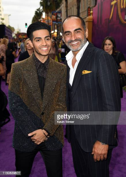 Mena Massoud and Navid Negahban attend the premiere of Disney's Aladdin at El Capitan Theatre on May 21 2019 in Los Angeles California