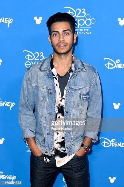 Mena Massoud attends Go Behind The Scenes With Walt Disney Studios during D23 Expo 2019 at Anaheim Convention Center on August 24 2019 in Anaheim...