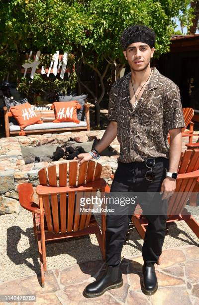 Mena Massoud attends Poolside with HM at Sparrow's Lodge on April 13 2019 in Palm Springs California