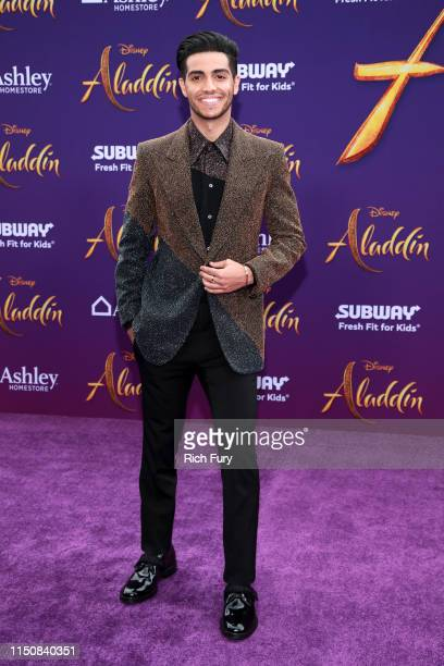 Mena Massoud attends the premiere of Disney's Aladdin on May 21 2019 in Los Angeles California