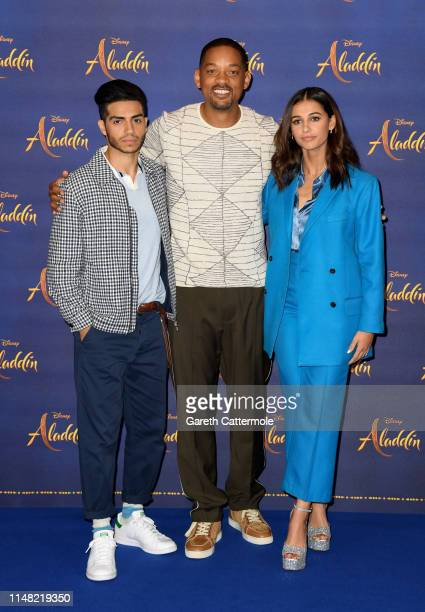 """Mena Massoud, Will Smith and Naomi Scott attend the photocall to celebrate release of Disney's """"Aladdin"""" at The Rosewood Hotel on May 10, 2019 in..."""