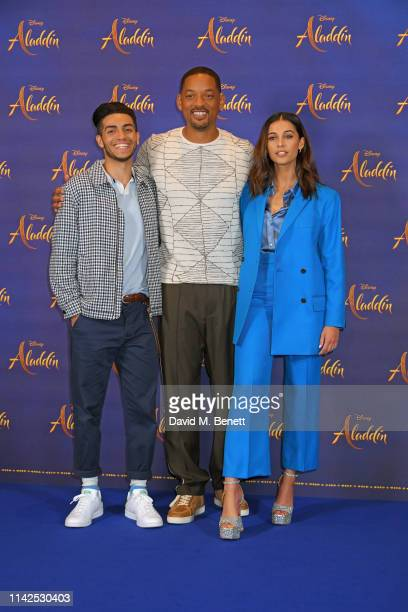 Mena Massoud Will Smith and Naomi Scott pose at a photocall during the Aladdin press conference held at the Rosewood London on May 10 2019 in London...