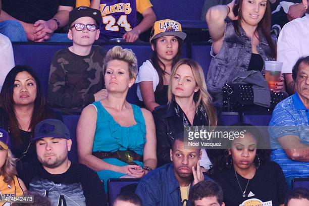 Mena Suvari and Kristina Mitchell attend a basketball game between the Brooklyn Nets and the Los Angeles Lakers at Staples Center on February 23 2014...