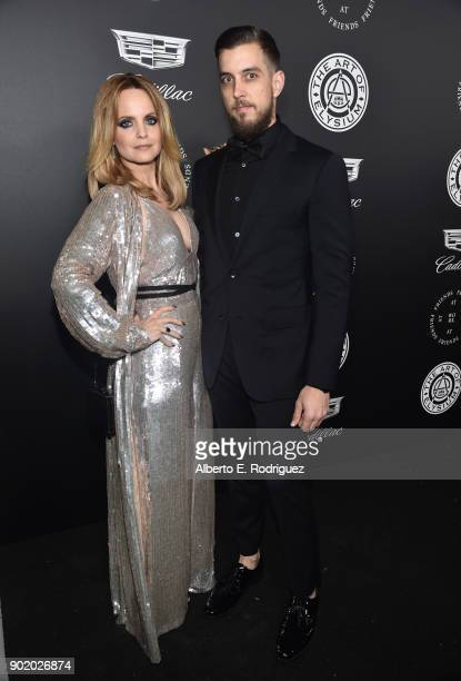 Mena Suvari and Michael Hope attend The Art Of Elysium's 11th Annual Celebration on January 6 2018 in Santa Monica California
