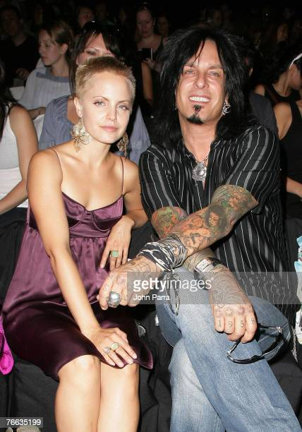 Mena Suvari and musician Nikki Sixx during the Rosa Cha 2008 Fashion Show at the Tent in Bryant Park during the MercedesBenz Fashion Week Spring 2008...