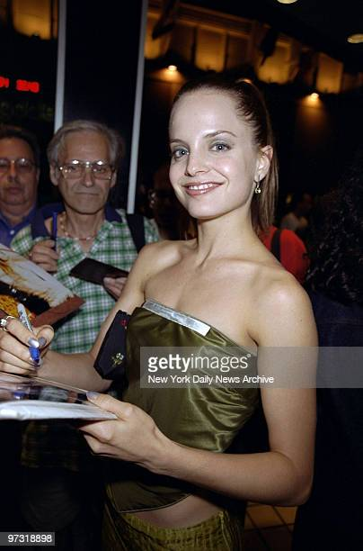 Mena Suvari obliges with an autograph at screening of the movie 'American Beauty' at Cinema One She's in the film