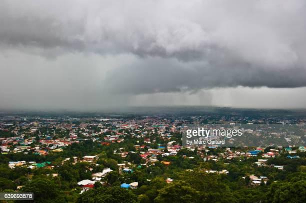 menacing storm over trinidad, trinidad & tobago - port of spain stock photos and pictures