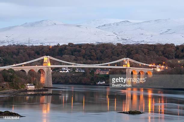 menai suspension bridge at dusk - menai straits stock pictures, royalty-free photos & images