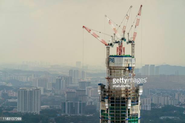 menara pnb 118 under construction in kuala lumpur, malaysia. - shaifulzamri stock pictures, royalty-free photos & images