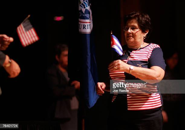 Menava Borroto originally from Cuba trades her Cuban flag in for an American flag during a naturalization ceremony August 30 2007 in Fort Lauderdale...