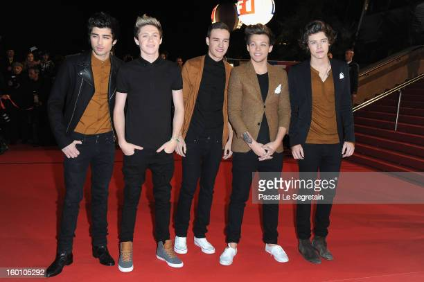 Menbers of band One Direction Zayn Malik Niall Horan Liam Payne Louis Tomlinson and Harry Styles attend the NRJ Music Awards 2013 at Palais des...