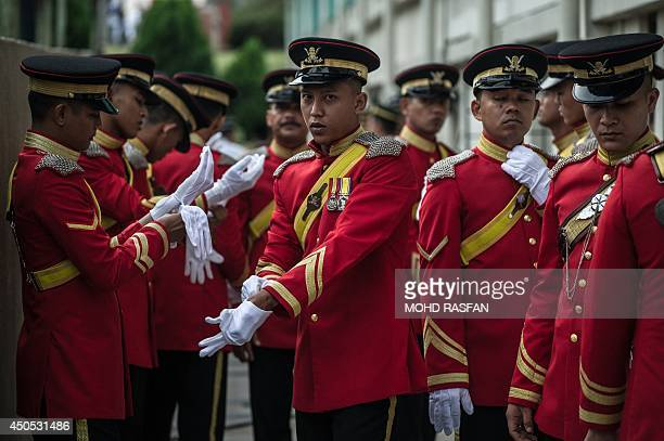 Menbers of Malaysia's Royal Lance Guard prepare themselves before the arrival of Malaysia's King Abdul Halim Mu'adzam Shah during his official...
