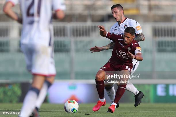 Mendes Murilo of AS Livorno Calcio battles for the ball with Vladimir Golemic of FC Crotone during the serie B match between AS Livorno and FC...