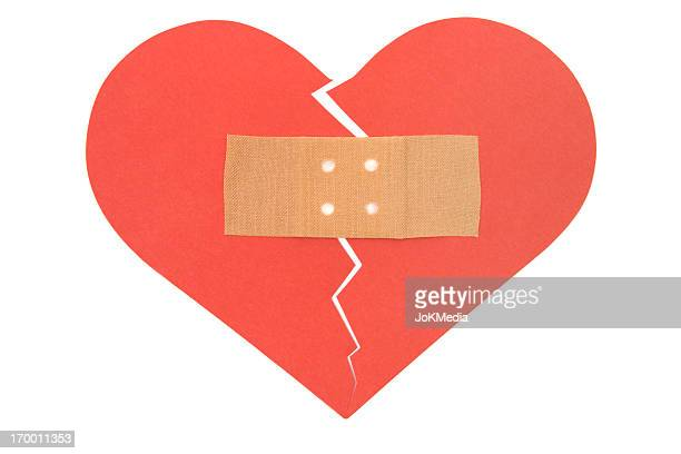 mending a broken heart - healing wound stock pictures, royalty-free photos & images