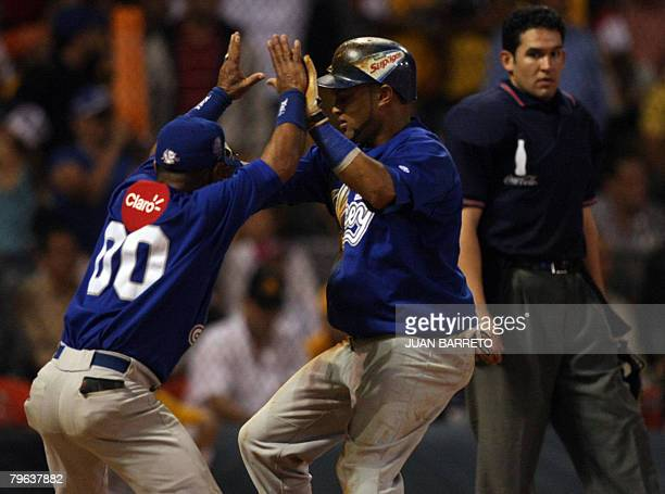 Mendy Lopez of Tigres del Licey of Dominican Republic celebrates with a batboy after hitting a homerun during a Caribbean Series game against Aguilas...