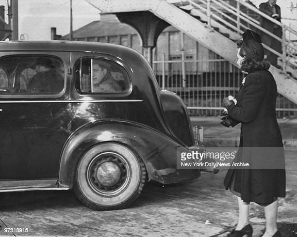 Mendy Weiss leaves for Sing Sing prison in police car as his wife looks on