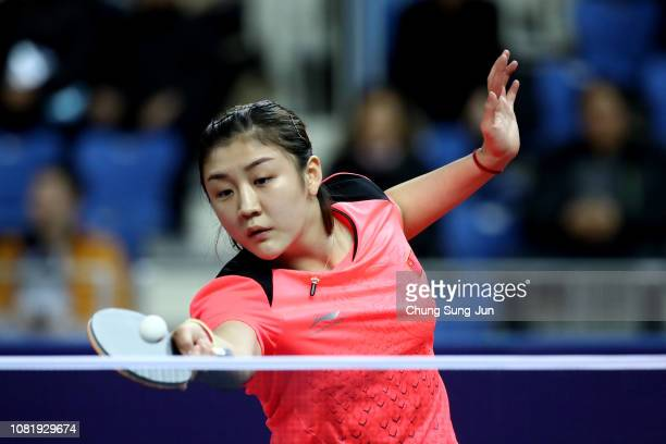 Meng Chen of China competes against Xingtong Chen of China in the Women's Singles - Round of 16 during day one of the World Tour Grand Finals at...