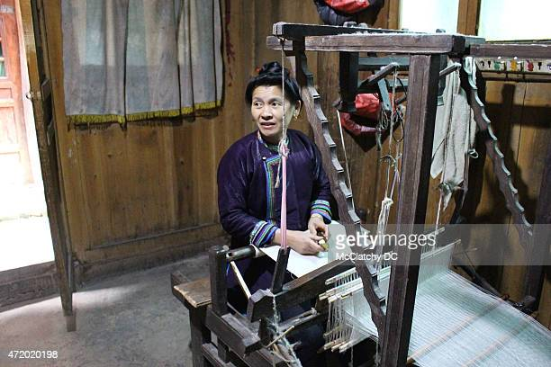 Meng Guangzhi weaves fabric on a traditional loom in Zengchong Guizhou province China on April 6 2015 Zengchong is one of Guizhou's best preserved...