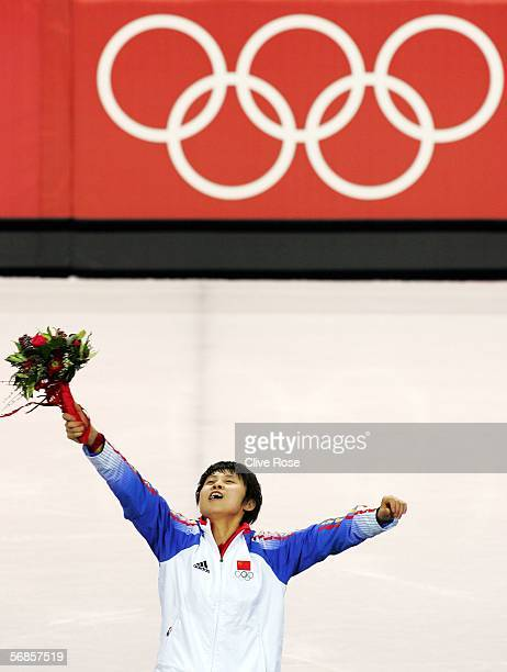 Meng Wang of China celebrates winning gold in the women's 500m Short Track Speed Skating Final during Day 5 of the Turin 2006 Winter Olympic Games on...