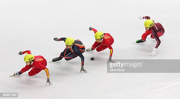 Meng Wang of China Evgenia Radanova of Bulgaria Tianyu Fu of China and Anouk LeBlancBoucher of Canada skate in the women's 500m Short Track Speed...