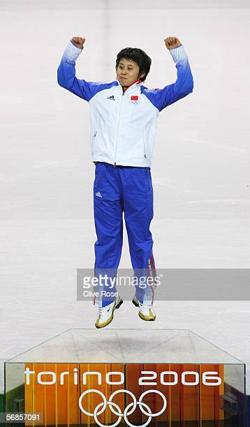 Meng Wang of China jumps in the air as she celebrates winning gold in the women's 500m Short Track Speed Skating Final during Day 5 of the Turin 2006...