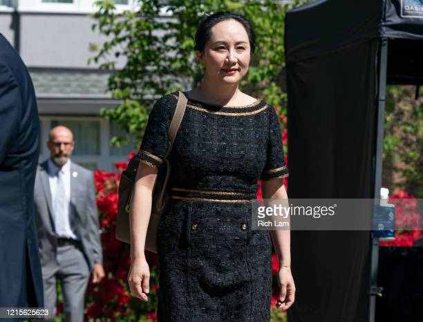 Meng Wanzhou, CFO of Huawei, walks down her driveway to her car as she departs her home for BC Supreme Court on May 27, 2020 in Vancouver, Canada....