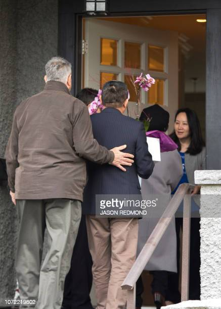 Meng Wanzhou Chief Financial Officer of Huawei Technologies answers the door for individuals carrying flowers after she was released on bail in...