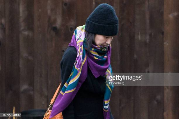 Meng Wanzhou chief financial officer of Huawei Technologies Co leaves her home under the supervision of security in Vancouver British Columbia Canada...