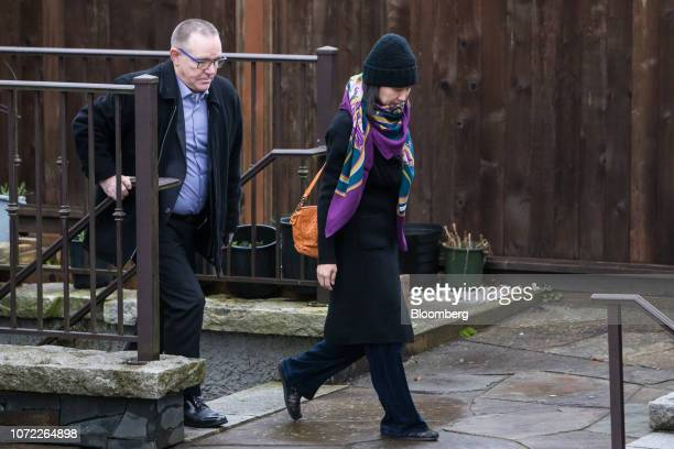 Meng Wanzhou, chief financial officer of Huawei Technologies Co., right, leaves her home under the supervision of security in Vancouver, British...