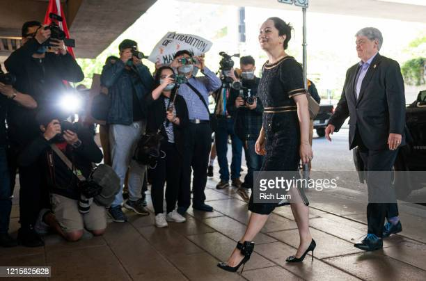 Meng Wanzhou walks past the media upon arriving at BC Supreme Court for her hearing on May 27, 2020 in Vancouver, Canada. Meng a Huawei executive is...