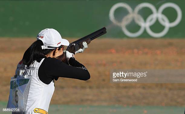Meng Wei of China competes in the semifinal match of Women's Skeet on Day 7 of the Rio 2016 Olympic Games at Olympic Shooting Centre on August 12...