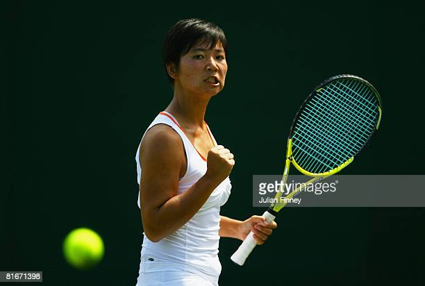 Meng Yuan of China celebrates a point during the women's singles round one match against Nathalie Dechy of France on day one of the Wimbledon Lawn...