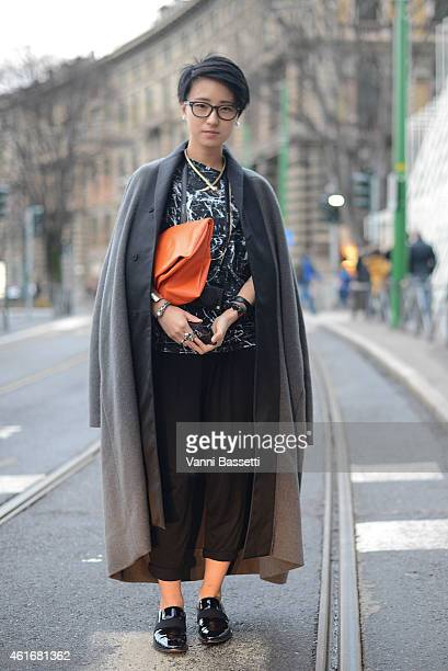 Mengdie Gin poses wearing a Rick Owens coat Alexander McQueen top and Cline shoes on January 17 2015 in Milan Italy