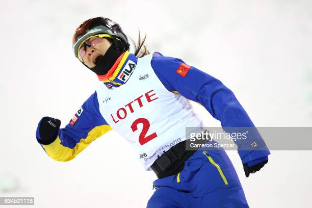 Mengtao Xu of China celebrates after landing a jump in the FIS Freestyle Ski World Cup 2016/17 Ladies Aerials final at Bokwang Snow Park on February...