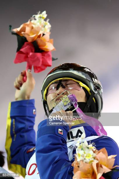 Mengtao Xu of China celebrates on the podium after winning the Ladies Aerials final at the FIS Freestyle Ski World Cup 2016/17 Aerials at Bokwang...