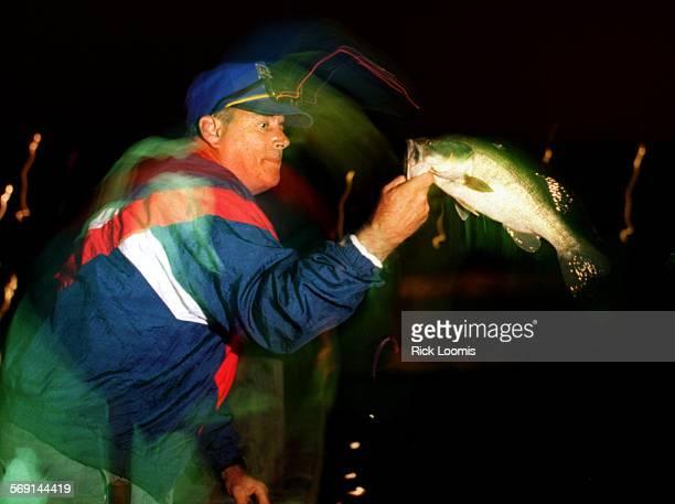 Nightfish#2.0529.RL–KODAK–Laguna Niguel–Rich Pearson, of Laguna Hills, fishes off the dock in the Sulpher Creek Reservoir at Laguna Niguel Regional...